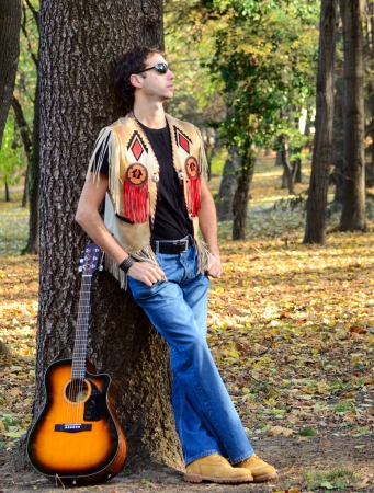 Man with guitar posing photo