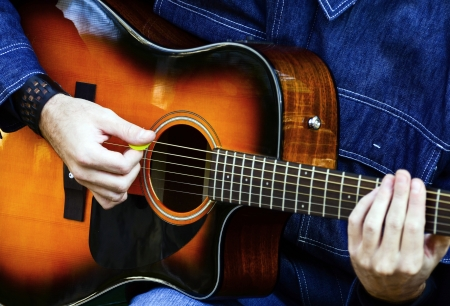 acoustic guitar: Man playing acoustic guitar