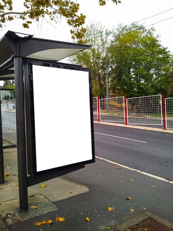 Bus stop with a blank bilboard photo