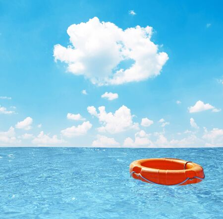 open sea: Help concept - Life buoy at open sea Stock Photo