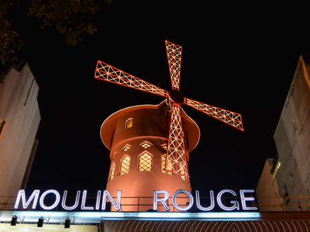 PARIS - OCT 29: The Moulin Rouge by night, on October 27, 2012 in Paris, France. Moulin Rouge is a famous cabaret built in 1889, locating in the Paris red-light district of Pigalle  Stock Photo - 16782254