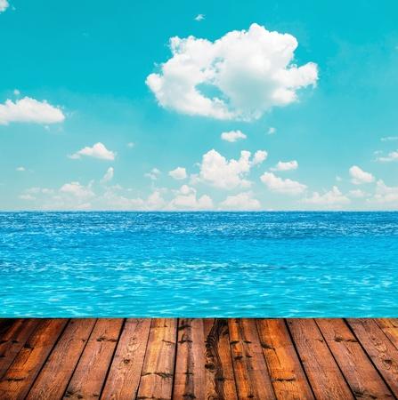 Blue ocean and sky above wooden floor Stock Photo