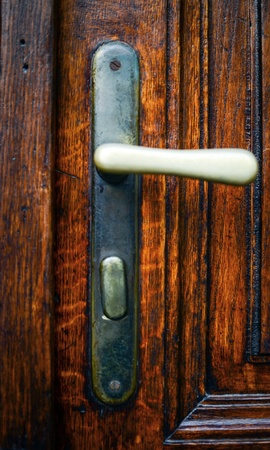 Old wood door with handle close-up photo