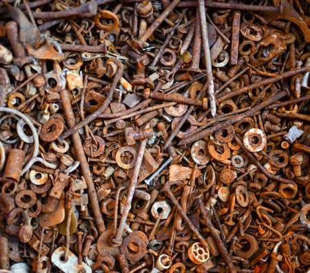 Rust backgound - Group of rusty screws bolts and nails photo