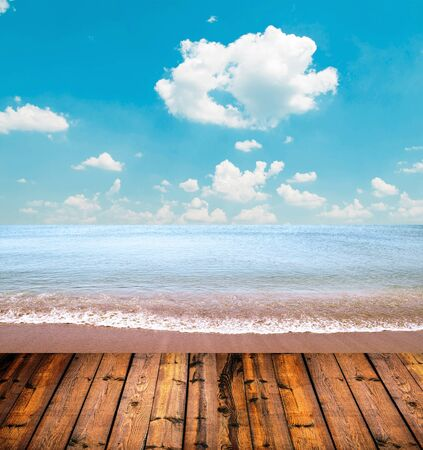 Tropical beach and wooden floor photo