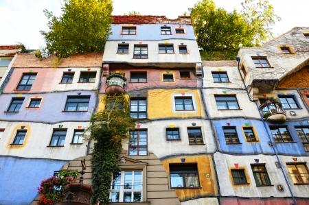 reasons: VIENNA - OCTOBER 13 2012: Hundertwasser Haus on OCTOBER 13 2012 in Vienna. The iconic building by famous architect is one of reasons to visit Vienna