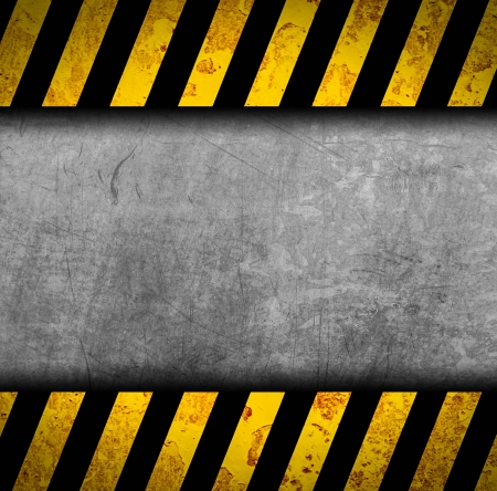 Grunge metal background with black and yellow warning stripes Stock Photo - 17119979