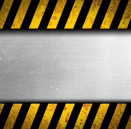 Grunge metal background with black and yellow warning stripes Stock Photo - 17120118