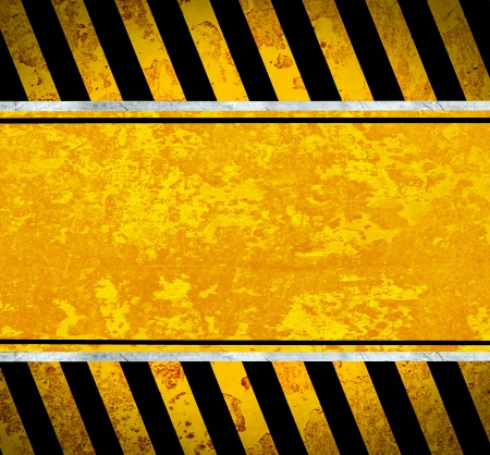 Grunge metal plate with warning stripes photo