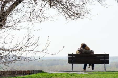 Romantic couple on bench photo
