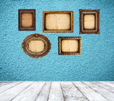 Retro blue room with empty frames photo