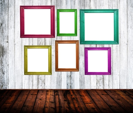 Empty room interior with colorful picture frames photo