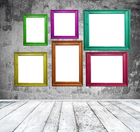Empty room with multicolored photo frames photo