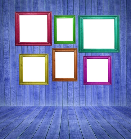 Retro room with colorful blank picture frames photo