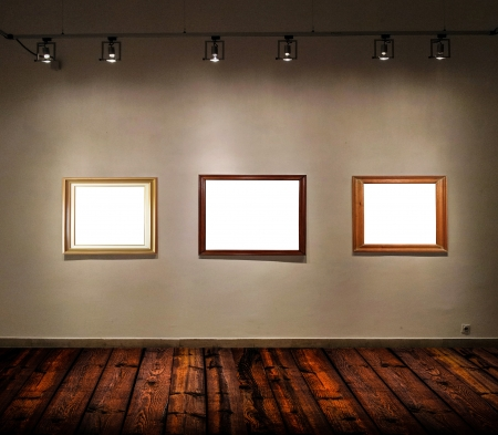 Empty frames in big gallery room photo