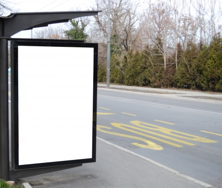 Blank billboard at the bus stop photo