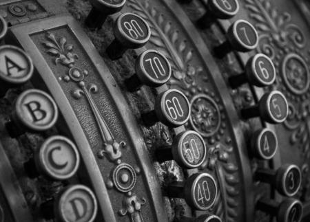 Antique cash register macro shot in bw Stock Photo