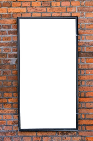Blank billboard on brick wall photo