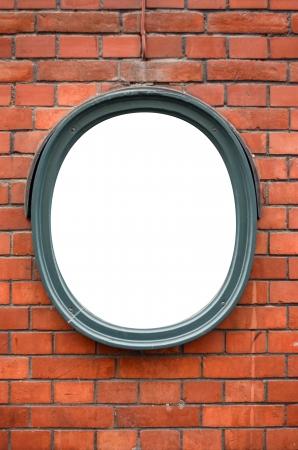 Blank ceramic frame on brick wall photo