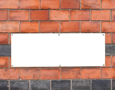 Blank sign on brick wall photo