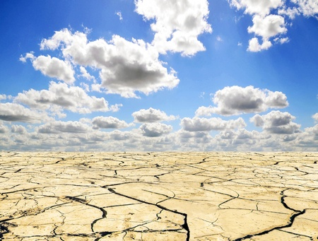 global warming: Drought landscape against bright blue sky with clouds