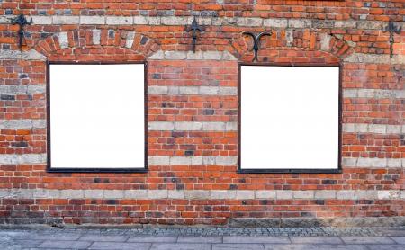 Empty billboards on brick wall photo