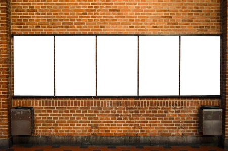 Five empty billboards on brick wall photo