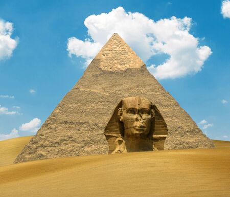 Great Pyramid of Pharaoh Khufu and the Sphinx on sand dunes - Egypt concept photo