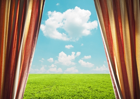 Open window curtains with green field photo