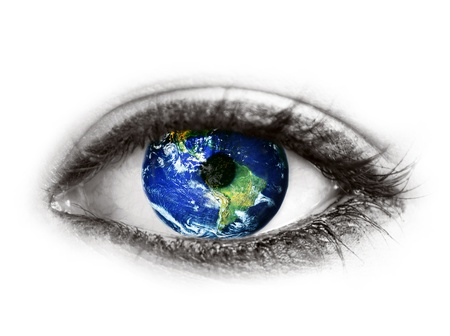 Planet earth in eye isolated on white - Elements of this image furnished by NASA Stock Photo