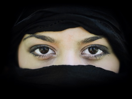 purdah: Portrait of beautiful Arab woman wearing black scarf