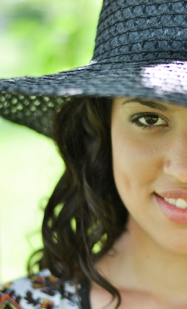 Half face shot of brunette girl with straw hat Stock Photo - 19377122