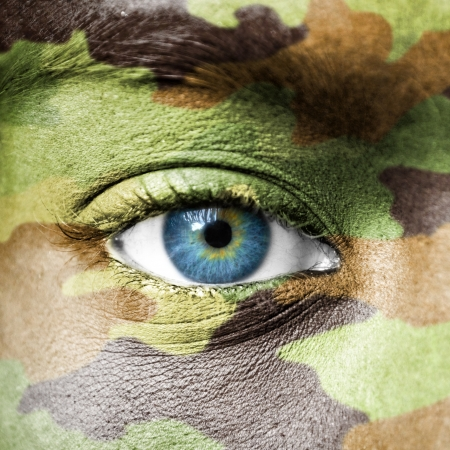 Soldier face with camo texture macro Stock Photo