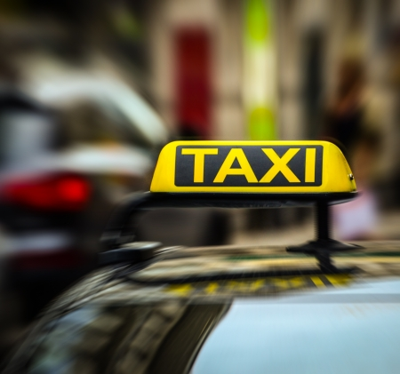 Taxi sign on car in motion blur Stock Photo - 19554439