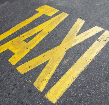 Taxi sign on street photo