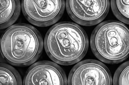 Abstract view of cold cans with refreshing drink background photo