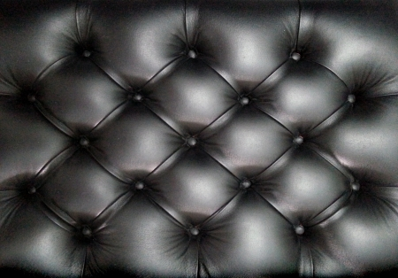 Black leather sofa texture photo