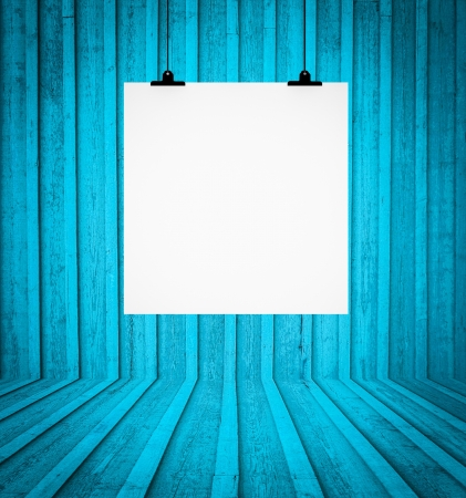 Blank board hanging at wall in blue retro room photo