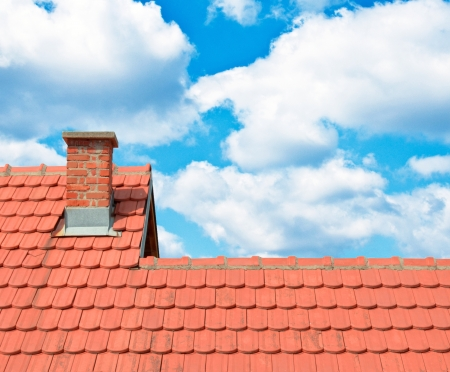 roof shingles: Brand new red rooftop against blue sky  Stock Photo