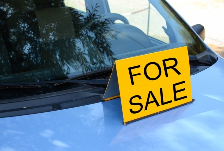 FOR SALE sign on car - Sell a car concept photo