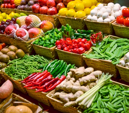 Fruit market with various colorful fresh fruits and vegetables photo