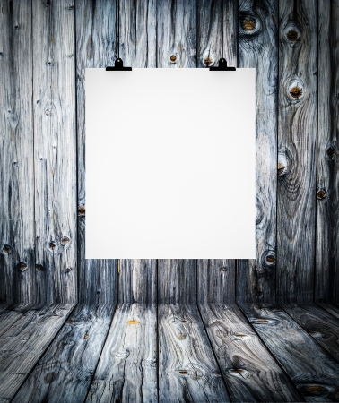 Interior of wooden empty room with white paper hanging on paper clips photo