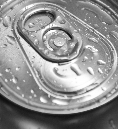 Macro shot of can with water drops photo