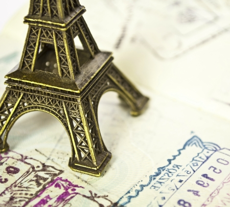 Stamped passport with Eiffel passport - Travel to Paris concept photo