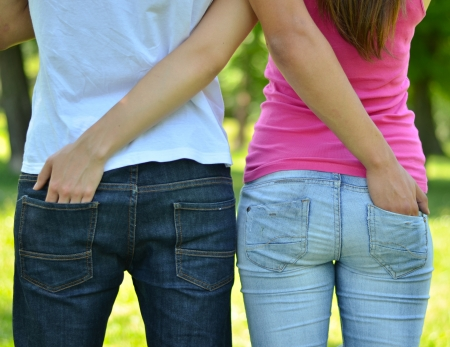 Teenagers couple outdoor with hands in each others pockets photo
