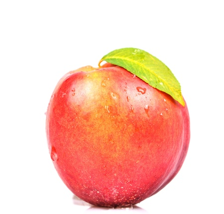 Fresh juicy peach isolated on white photo