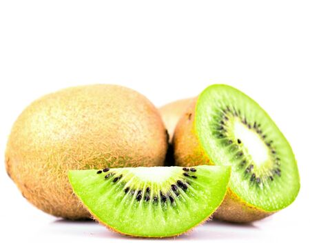 Kiwi fruit and his sliced segments isolated on white background cutout photo