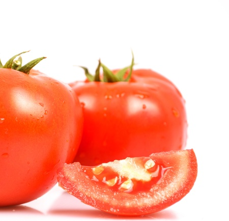 Tomato vegetables pile isolated on white background photo