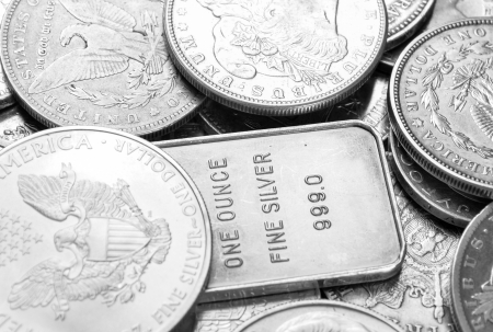 an ounce: Silver coins and bars macro shot