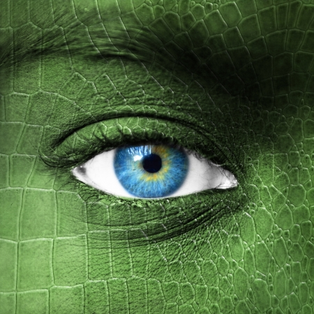 amphibians: Human eye with lizard skin texture - Mutation concept  Stock Photo